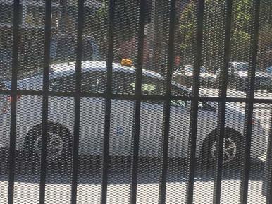 Parked acorss the driveway.